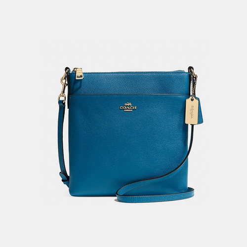 COACH NORTH/SOUTH swingpack LIGHT GOLD/DENIM
