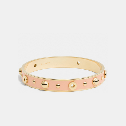 COACH ENAMEL grommets and rivets bangle GOLD/APRICOT