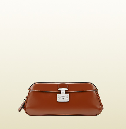 Gucci lady lock leather clutch