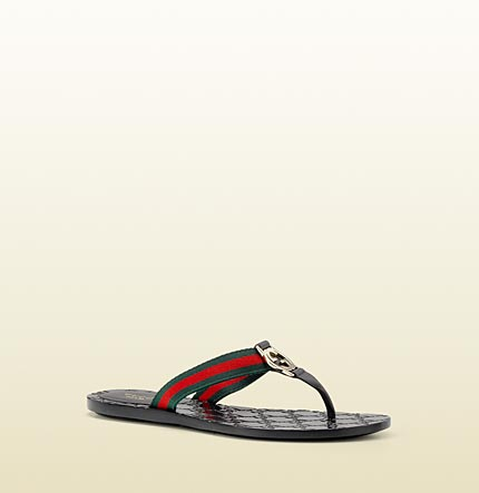 Gucci GG thong with double G ornament and web detail.