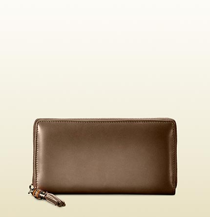 Gucci womens 1921 collection zip around wallet with tassel and bamboo detail.