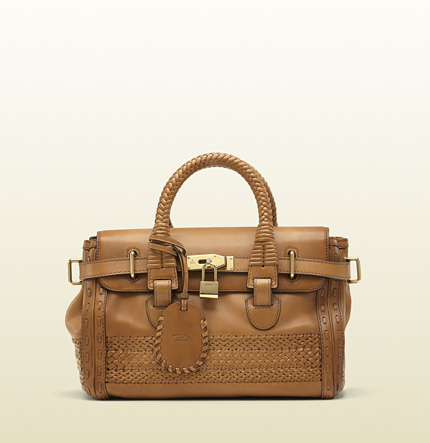 Gucci handmade medium top handle bag with woven web detail.