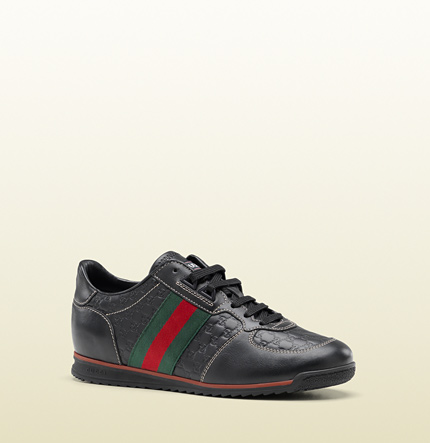 Gucci SL73 lace-up sneaker with signature web, gucci label on tongue, and interlocking G on back.