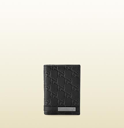 Gucci card case with metal bar and engraved interlocking G.