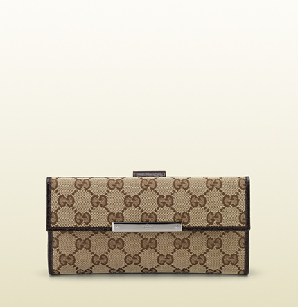 Gucci continental wallet with gucci trademark engraved metal plate.