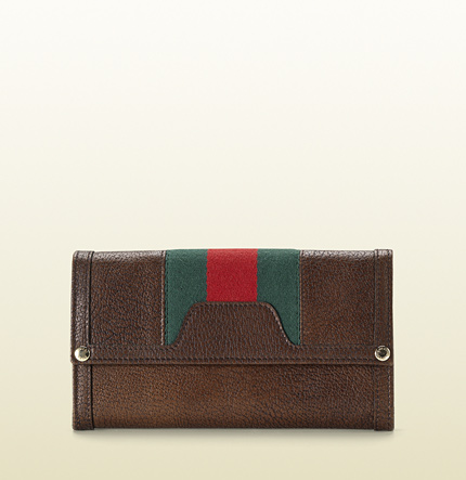 Gucci continental wallet with signature web.